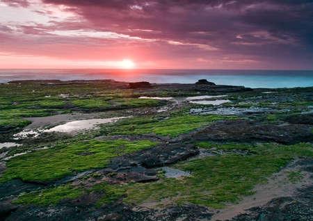 East coastline of Australia near Sydney, at sunrise, with a ship on the horizon Stock Photo