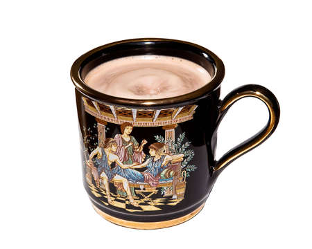 A decorated coffee mug filled to the brim with coffee