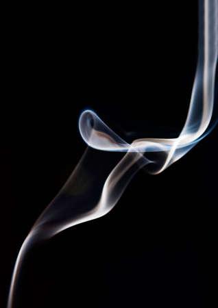 Abstract image of raising smoke on black background Stock Photo