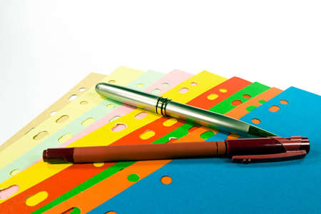 Divider set and pens on white background