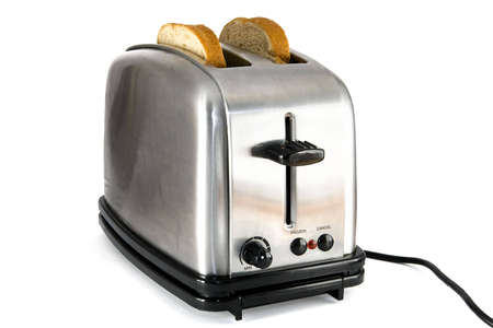 Shiny chrome toaster with two slices of bread, on white background photo