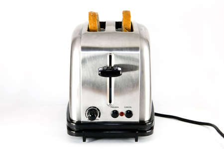 Shiny chrome toaster with two slices of bread, on white background