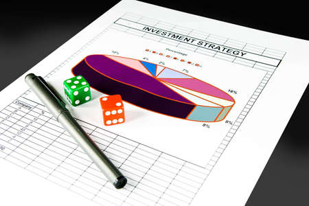 Investment strategy chart and set of dice, with clipping path