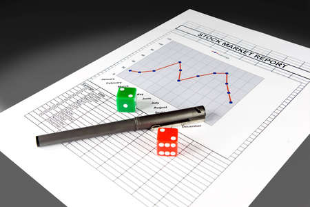 stock quotations: Stock market report and set of dice, with clipping path