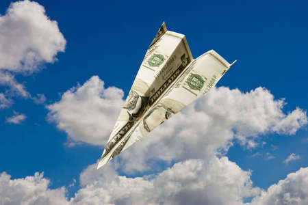 Paper plane made out of dollar notes flying in blue sky Stock Photo - 3179342