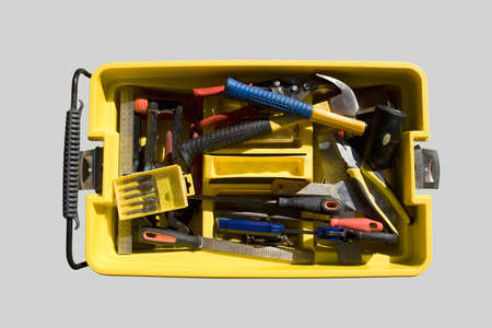 Yellow toolbox tray with various tools