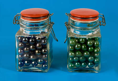 Two glass jars with red lids