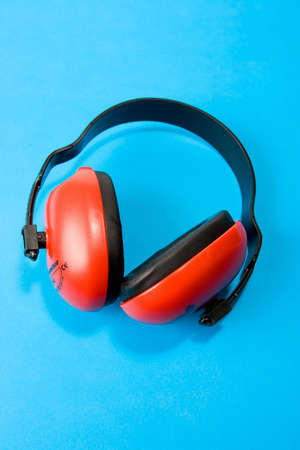 Hearing protection earmuffs on blue background Stock Photo