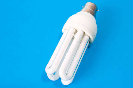 Energy saving bulb on blue background