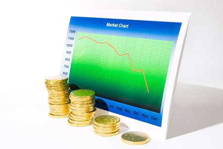 Market chart with declining graph and a stack of money Stock Photo