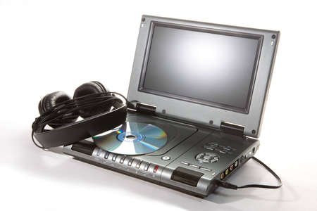 DVD player with headphones on white background Stock Photo