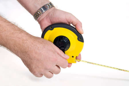 Hands holding flexible measuring tape, on white background