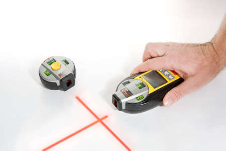Electronic laser level with stud finder on white background