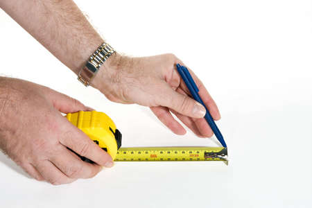 Measurement with measuring tape, on white background Stock Photo