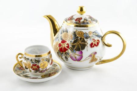 teacup: Antique porcelain tea and coffee set.