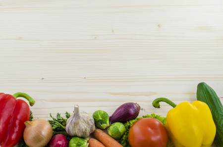 Wooden table with fresh vegetables. Background. photo