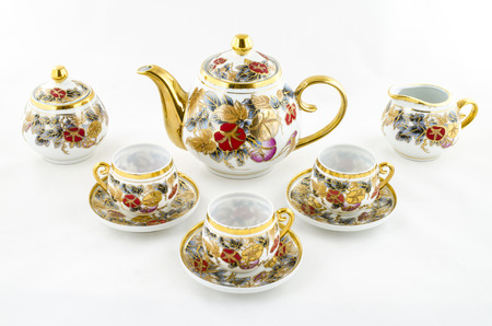 Antique porcelain tea and coffee set with flower motif photo