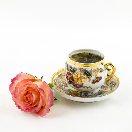 Porcelain tea cup with rose flower photo