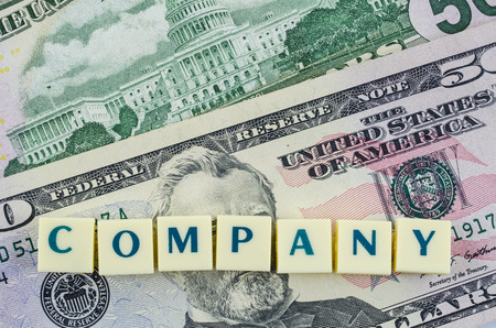 Company word on dollar background. Finance concept photo