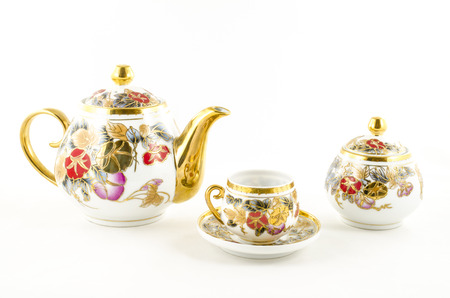 porcelain flower: Porcelain tea and coffee set with flower motif Stock Photo