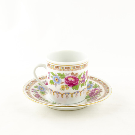 porcelain flower: Porcelain tea and coffee cup with flower motif