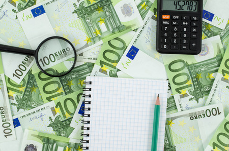 Empty notebook on euro banknotes background photo