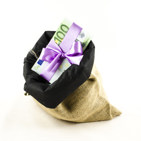 Money with pink bow in jute bag photo