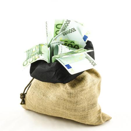 Jute bag full of money on white background photo