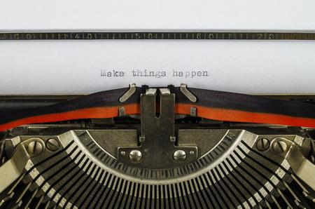 Make things happen word printed on an old typewriter