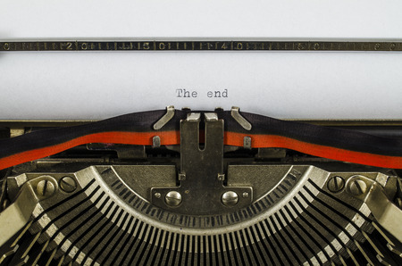 The end word printed on an old typewriter