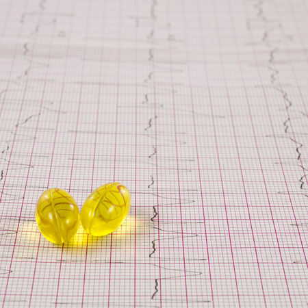 of electrocardiogram: Electrocardiogram with pills Stock Photo