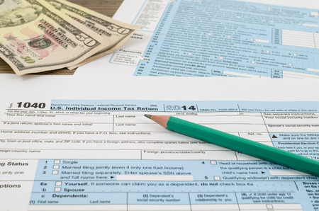 U.S. individual income tax return form 1040 with pencil