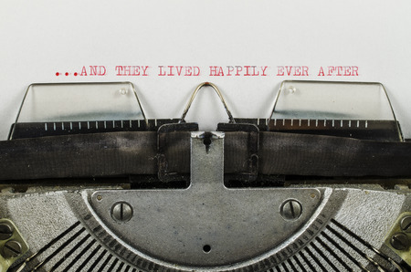 lived: and they lived happily ever after word printed on old typewriter Stock Photo
