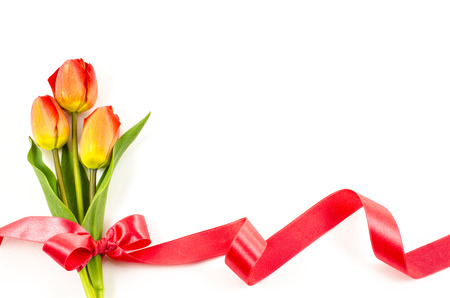Empty postcard background with colorful flowers and red ribbon photo