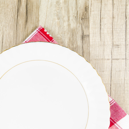 Plate on wooden table Stock Photo