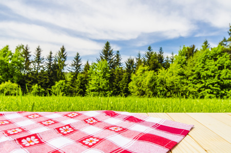 red tablecloth: Red tablecloth on wooden table Stock Photo