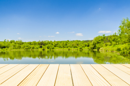 Empty wooden table with landscape background photo