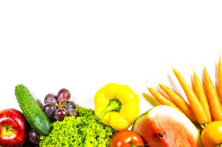Frame of fresh fruits and vegetables on a white background Standard-Bild