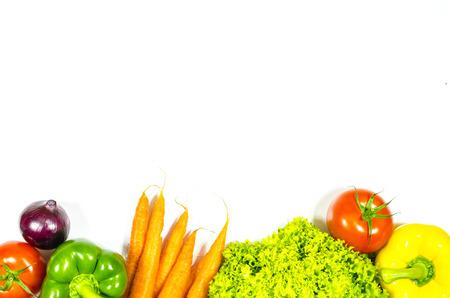 Frame of fresh vegetables on white background