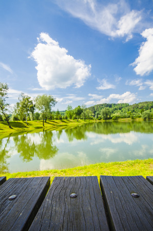 backdrop colorful: Empty wooden table with landscape background
