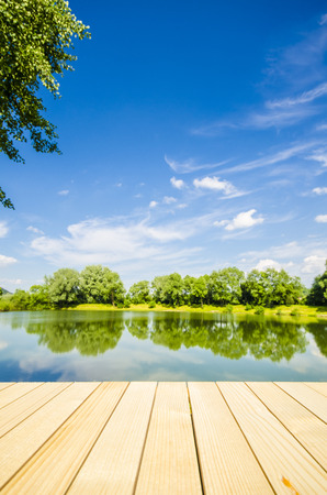 Empty wooden table with landscape background
