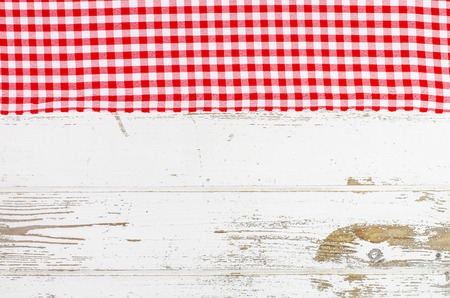 red tablecloth: Red tablecloth over wooden table