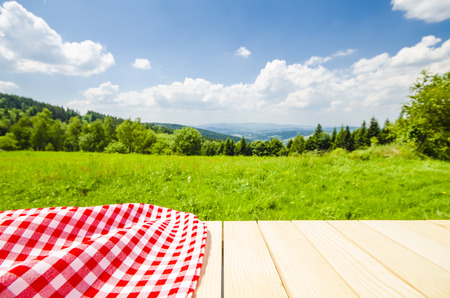 picnic cloth: Empty table with landscape background Stock Photo