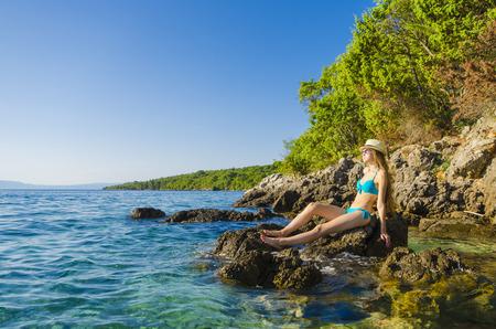 beautiful weather: Young beautiful woman on tropical beach