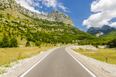 albanian: Empty road to Theth village in Albanian mountains Stock Photo