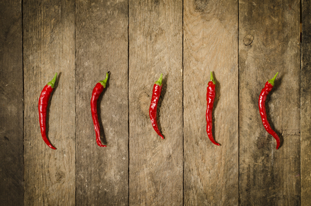 Red paprika over wooden table Stock Photo