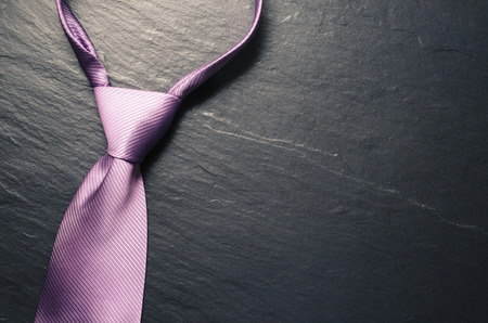 Elegant tie on dark background