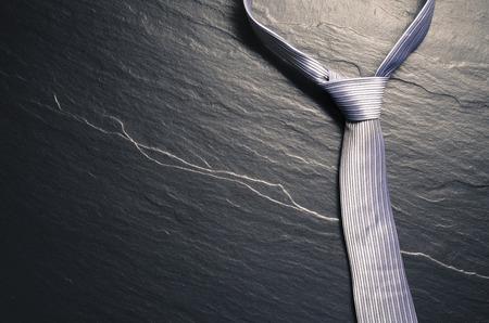 Elegant tie on dark background