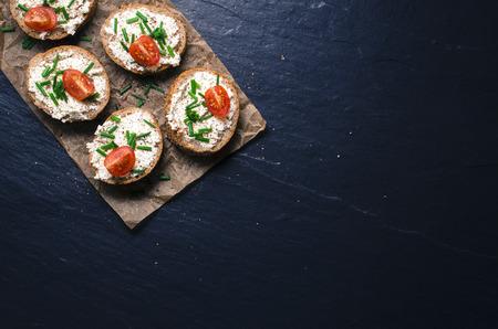 Mini sandwiches on dark background. Top view Zdjęcie Seryjne