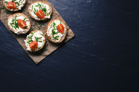 white table: Mini sandwiches on dark background. Top view Stock Photo